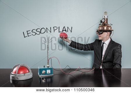 Lesson plan concept with businessman holding brain