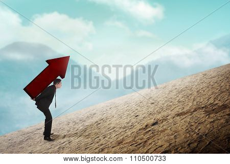 Asian Business Man Carry Big Red Arrow On His Back