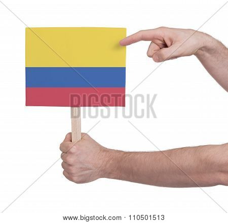 Hand Holding Small Card - Flag Of Colombia
