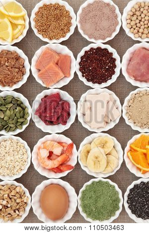 Health and body building high protein super food of meat, fish, dairy, supplement  powders, seeds, pulses,   nuts, fruit, vegetable and herb selection.