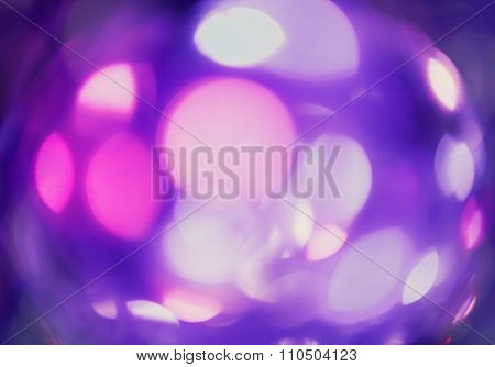 Abstract violet background with circles. Holiday pink bokeh. Defocused background