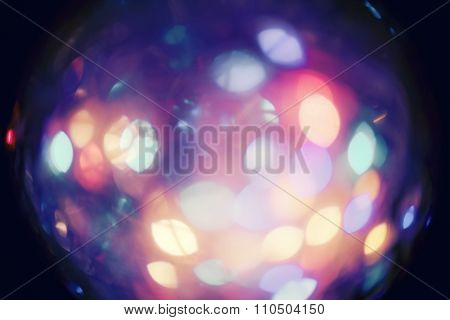 Abstract colorful circular bokeh of Christmaslights with vignette toned in vintage film color