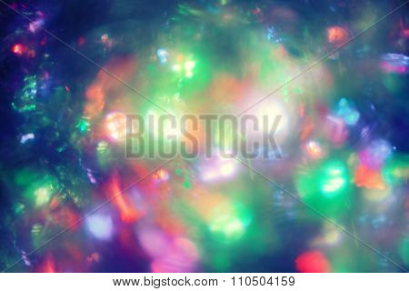 Abstract circular bokeh background of Christmaslights. Defocused garland