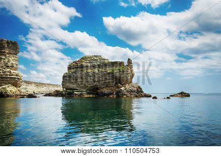 View From The Sea On A Rocky Shore