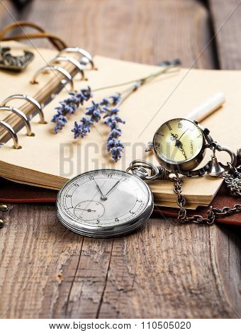 Vintage Grunge Still Life With Pocket Watch, Lavender Flower And Old Book.
