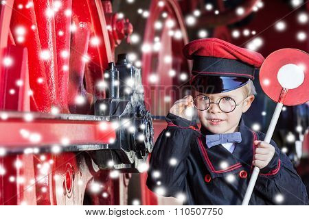 Smiling Train Conductor Boy in Winter