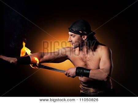 Handsome men performing fire show
