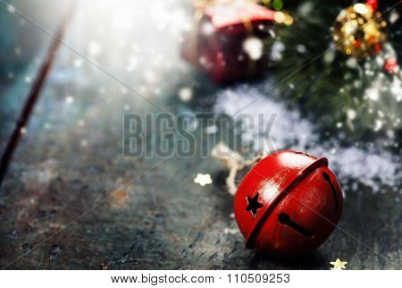 Christmas Jingle bells  on a rustic wooden background