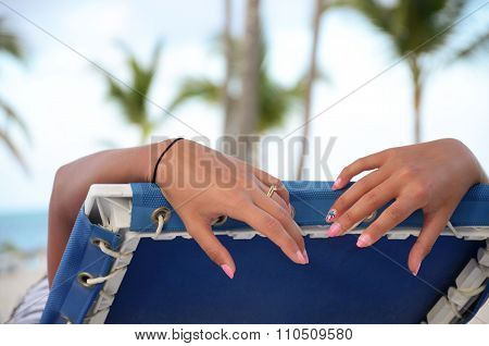 Tourist In A Deckchair On The Beach