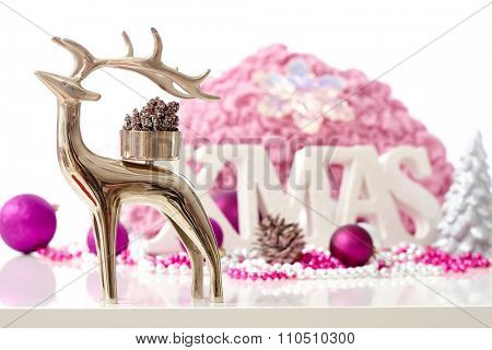 Christmas decoration with reindeer and ornaments.
