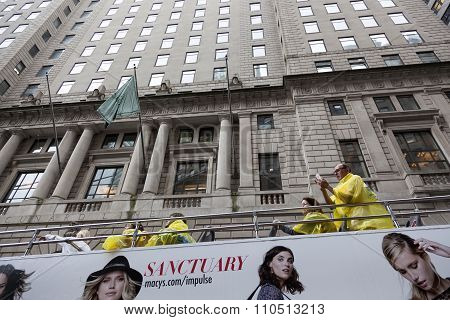 Tourists On Sightseeing Bus In Front Of Wall Street Stock Exchange In Downtown Manhattan.