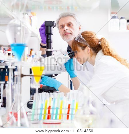 Health care professionals in lab.