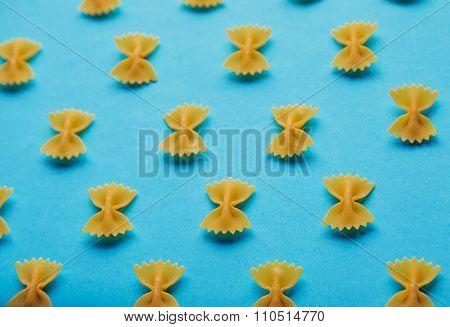 Italian Farfale Pasta Pattern On Blue Background Side View