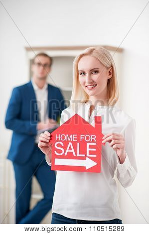 Beautiful blond lady is selling her house