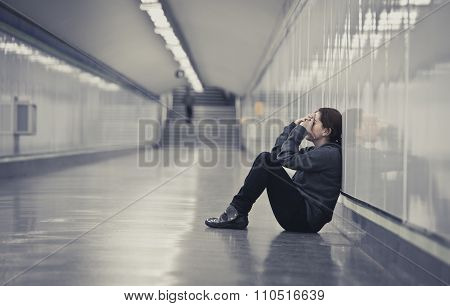 Young Sad Woman In Pain Alone And Depressed At Urban Subway Tunnel Ground Worried Suffering Depressi