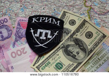 Kiev, Ukraine.NOV 13.Illustrative editorial. Chevron of Islamic extremist formation Crimea as part of Ukrainian Army.Background map and money. November 13, 2015 in Kiev, Ukraine