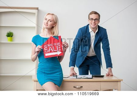 Attractive two realtors are advertising their business