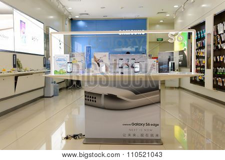 SHENZHEN, CHINA - MAY 25, 2015: interior of store with Samsung gadgets. Samsung is a South Korean multinational conglomerate company headquartered in Samsung Town, Seoul