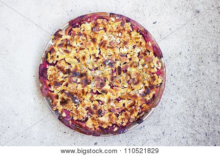 Freshly Baked Plum Pie With Almonds And Crumble On Top