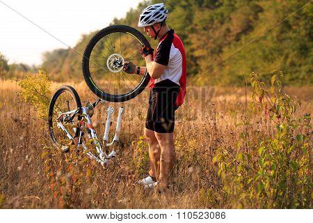 Bike repair. Young man repairing mountain bike
