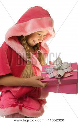 Little beautiful Christmas girl opens her present