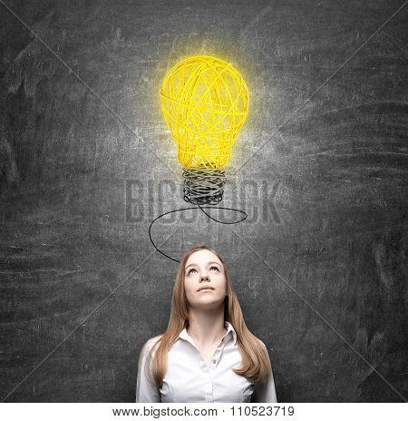 Woman Looking At A Bulb Thinking About Problem Solution