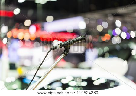 Microphone In Event  Hall With Blurry Bokeh
