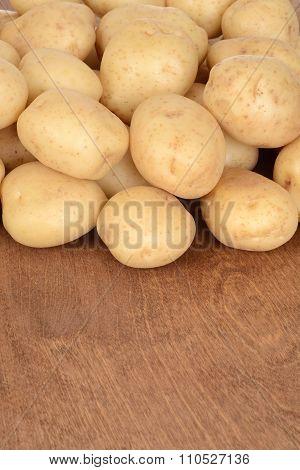 new potatoes on wood