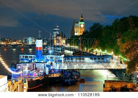 LONDON, UK - SEP 27: Thames River night view with ship on September 27, 2013 in London, UK. London is the world's most visited city and the capital of UK.