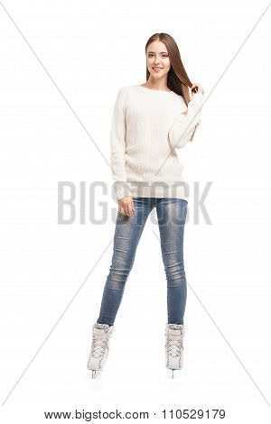 young woman in pair of ice skates isolated