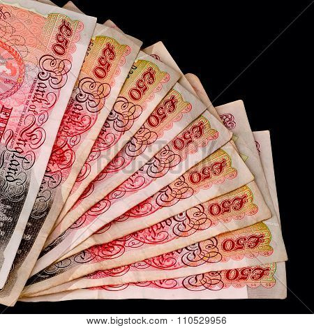 Fifty pound sterling banknotes fanned out with clipping path black background square