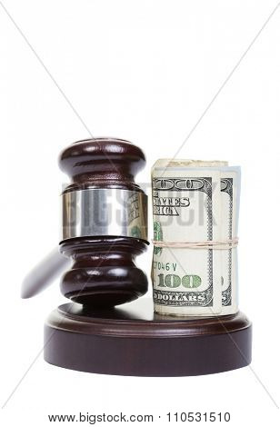 Law gavel with a roll of American money.