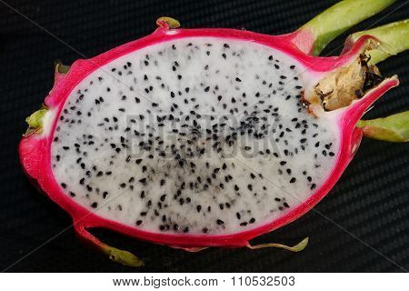 Fruit red shell tasty white flesh with black seeds.
