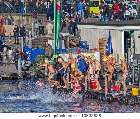 Zurich Samichlaus-schwimmen Participants Jumping Into The Water