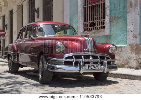 Red taxi in Cuba