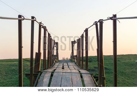 Tension Bridge Stretching Into Sunset