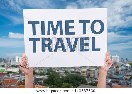 Time To Travel sign Hands holding blank paper over head background panoramic aerial view big city to