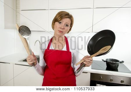 Home Cook Woman In Red Apron At Domestic Kitchen Holding Pan And Household In Stress