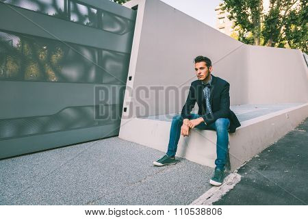 Young Handsome Man Posing In The City Streets