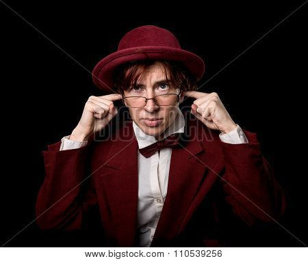 Strange person in cherry hat and bow-tie