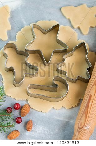 Baking Christmas Cookies - Dough On The Table, Cookie Cutters And Cookies