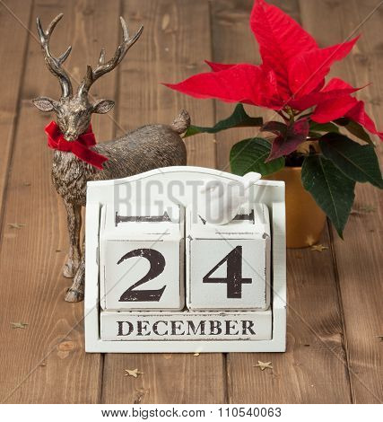 Christmas Eve Date On Calendar. December 24. Poinsettia Flower.