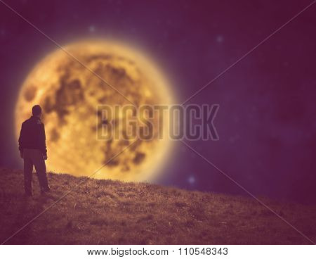 Man watching the stars and moonrise