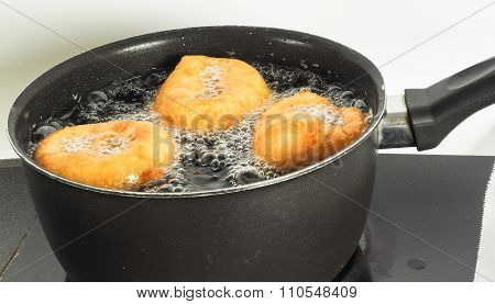 Donuts Cooking In Boiling Oil In Kettle