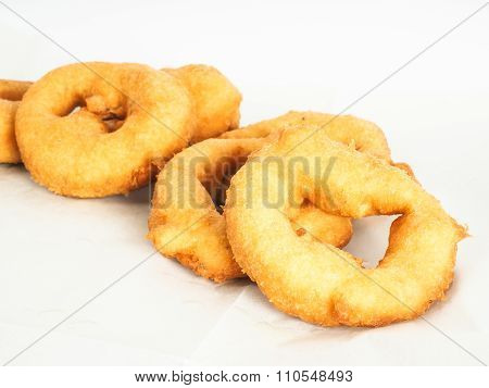 Closeup Of Doughnuts In Pile On Baking Paper