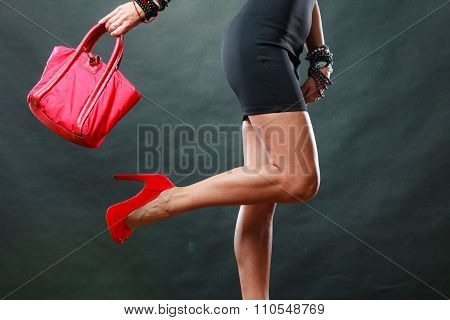 Girl In Black Short Dress Red Spiked Shoes Holds Handbag