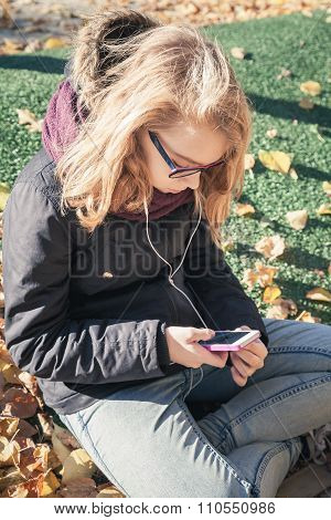 Caucasian Blond Teenage Girl With Cellphone