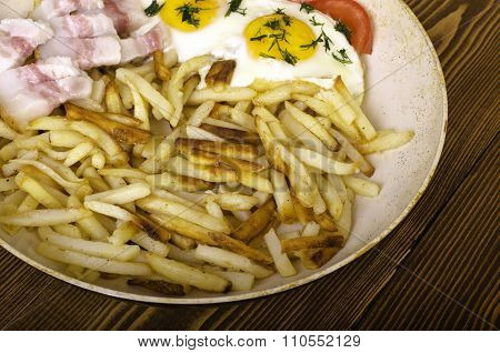 Breakfast For Two. Frying Pan With Two Fried Eggs And Fried Potatoes.