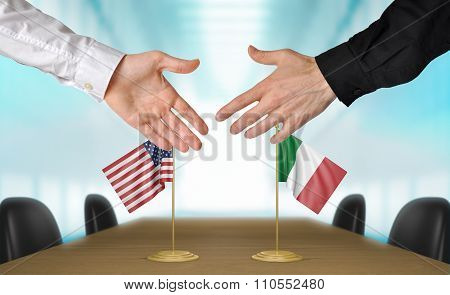 United States and Italy diplomats shaking hands to agree deal