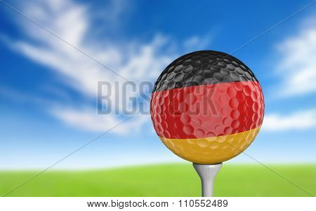 Golf ball with Germany flag colors sitting on a tee